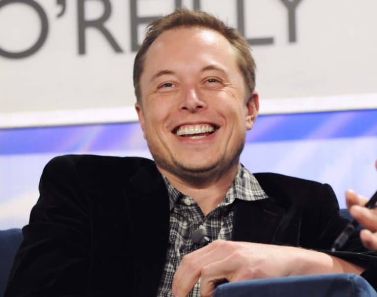 Tesla stock price reaches all time high of $1900 ahead of 5 for 1 stock split. it's no wonder Elon Musk has plenty to smile about.